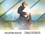 businessman looking up holding... | Shutterstock . vector #286255835