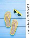 summer accessories on blue... | Shutterstock . vector #286386911