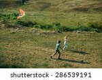 lovely couple play air kite at... | Shutterstock . vector #286539191