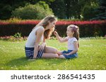 mother and daughter having fun... | Shutterstock . vector #286541435