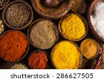 spices and herbs in wooden bowls | Shutterstock . vector #286627505