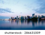 Stock photo vancouver skyline at sunset as seen from stanley park british columbia canada 286631009