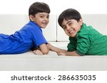 cute smiling boys lying on sofa | Shutterstock . vector #286635035