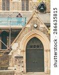 Builders Repairing Roof Of A...