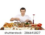 young man about to eat a leg of ... | Shutterstock . vector #286641827