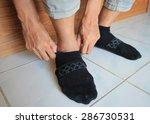 hand of man wearing black sock  | Shutterstock . vector #286730531