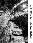 Small photo of Scene from Ialomita cave, near Padina plateau, Bucegi, Romania. Monochrome photography