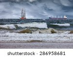 oil rig with ship at sea during ...   Shutterstock . vector #286958681