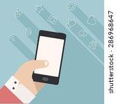 vector hand holding smartphone... | Shutterstock .eps vector #286968647
