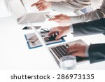 business team at work during a... | Shutterstock . vector #286973135