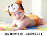 cheerful baby at home portrait | Shutterstock . vector #286988381
