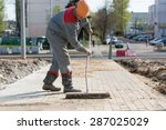 Construction Worker Grouting...