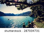 lake como. people on a boat... | Shutterstock . vector #287034731