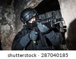 Special forces/ anti-terrorist police unit/private military contractor during night CQB hostage rescue raid/operation/mission (very harsh light for underline the atmosphere)