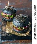delicious black burgers on... | Shutterstock . vector #287099885
