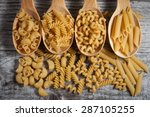 Various Mix Of Pasta On Wooden...