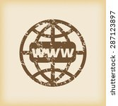 grungy brown icon with globe...