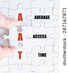 Small photo of Hand of a business man completing the puzzle with the last missing piece.Concept image of Business Acronym AAT as Average Access Time