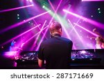 dj with headphones at night... | Shutterstock . vector #287171669