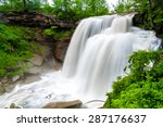 Brandywine Falls in Cuyahoga Valley National Park at full force after heavy spring rains, rendered silky with slow shutter exposure
