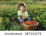 cheerful boy with basket of... | Shutterstock . vector #287223275