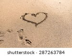 Heart Drawn On Ocean Beach Sand