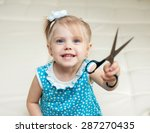 Little Girl With Scissors In...