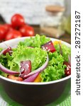 bowl of fresh green salad on... | Shutterstock . vector #287272187