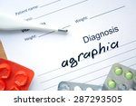 Small photo of Diagnostic form with diagnosis Agraphia and pills.