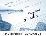 Small photo of Diagnostic form with diagnosis abulia and pills.