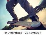 skateboarder legs riding... | Shutterstock . vector #287295014