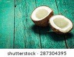 coconut on wooden table.vintage ... | Shutterstock . vector #287304395