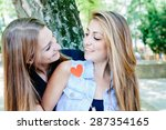 couple two young women at the... | Shutterstock . vector #287354165