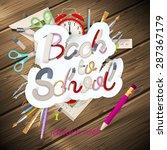 school supplies on wooden... | Shutterstock .eps vector #287367179