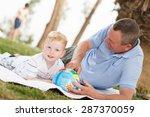 portrait of smiling grandson... | Shutterstock . vector #287370059