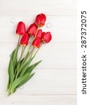 Red Tulips Bouquet Over White...