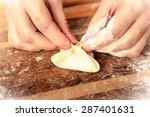 woman cooks dumplings. | Shutterstock . vector #287401631