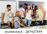 group of smiling adult students ... | Shutterstock . vector #287427599