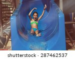 Child Sliding Down Water Slide...