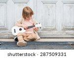 Little Happy Boy Plays His...