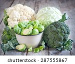 Assortment Of Cabbages On Old...