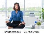 Asian Businesswoman Sitting On...