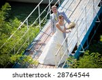 smiling groom and bride - stock photo