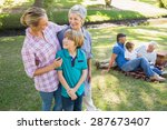 happy family in the park on a... | Shutterstock . vector #287673407