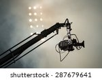 Small photo of TV camera on a crane on football mach or concert
