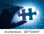 hand insert jigsaw  conceptual... | Shutterstock . vector #287726447