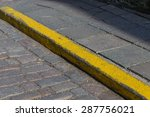 Yellow Curb Stone Border In An...