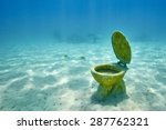 the wc toilet lying on the sea... | Shutterstock . vector #287762321