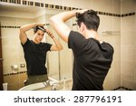 reflection of young man bushing ... | Shutterstock . vector #287796191