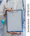 doctor holds blue clipboard... | Shutterstock . vector #287821451